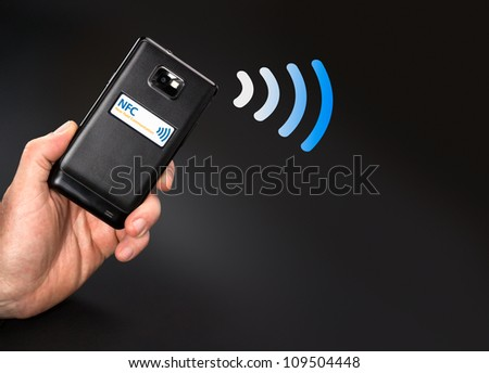 NFC - Near field communication / contactless payment with mobile phone - stock photo