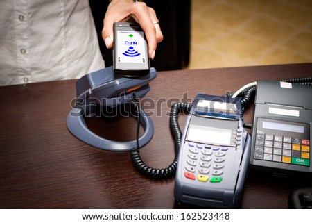 NFC - Near field communication / mobile payment - stock photo