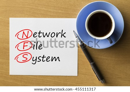 NFS Network File System - handwriting on paper with cup of coffee and pen, acronym business concept