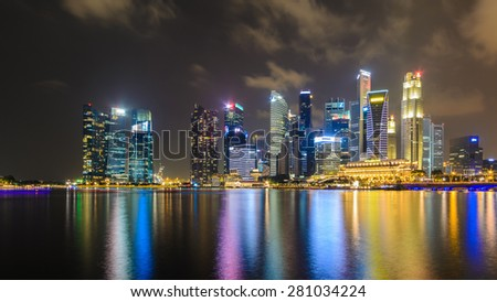 NGAPORE, SINGAPORE - October 6, 2014: Merlion in Singapore.Tourist gathering at the Merlion in Singapore on October 6. Merlion is a central gathering spot for tourists in Singapore. - stock photo