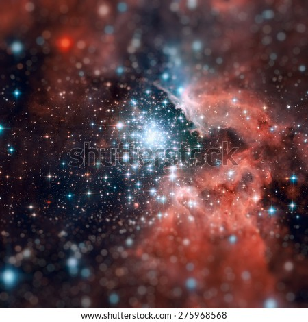 NGC 3603 is an open cluster of stars situated in the Carina spiral arm of the Milky Way around 20,000 light-years away. Retouched image with small DOF. Elements of this image furnished by NASA. - stock photo