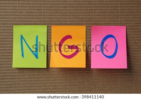 NGO (Non-Governmental Organization) acronym on colorful sticky notes - stock photo