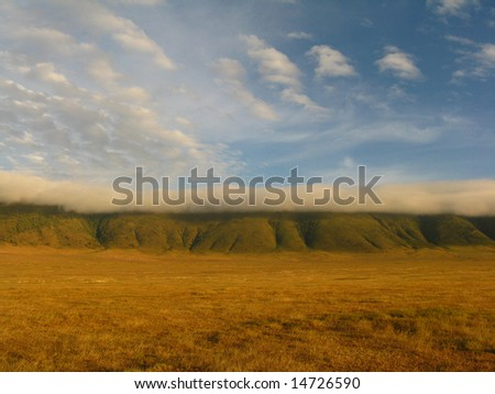 Ngorongoro Crater with Clouds - stock photo