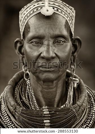 NGURUNIT - KENYA - JANUARY 19, 2015: Unidentified old Samburu woman with traditional necklace poses for a portrait on January 19, 2015 in Ngurunit, Kenya. - stock photo