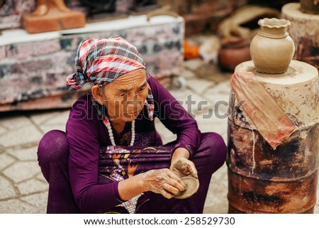 Nha Trang, VIETNAM - CIRCA February 2015 - unidentified woman creates clay pot  traditional handicraft in Vietnam