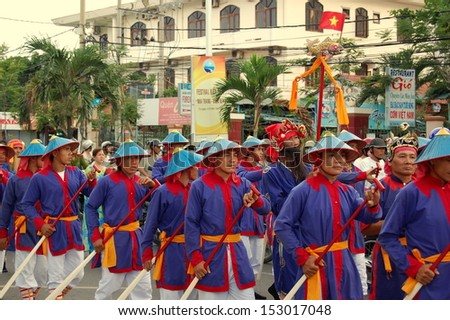 NHA TRANG, VIETNAM - JUNE 14: A group of unidentified men in traditional costumes is taking part in the parade on Bien Festival, June 14, 2011 in Nha Trang, Vietnam