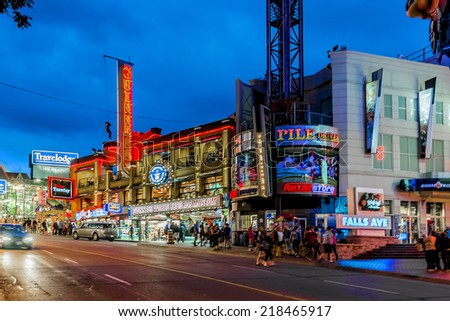 NIAGARA FALLS, CANADA - JUNE 30, 2014: Niagara Falls city by night, Canadian city on the western bank of the Niagara River. City has many business and entertainments options design for tourism.