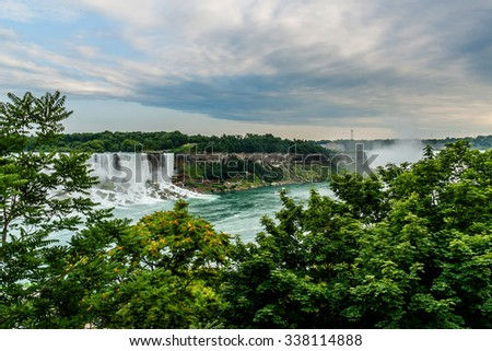 Niagara Falls closeup panorama at evening. Ontario, Canada. - stock photo