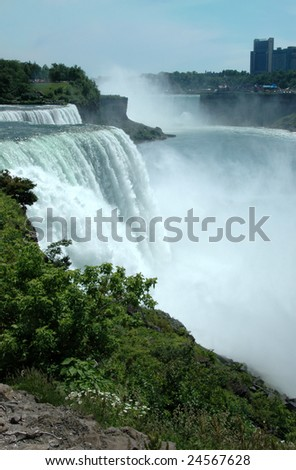Niagara Falls from the US side.  American Falls, Bridal Veil Falls, and Horseshoe Falls in the distance. - stock photo