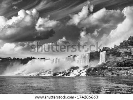 Niagara Falls. Power of nature against the sky at sunset. - stock photo