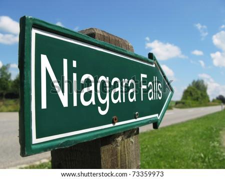 NIAGARA FALLS signpost along a rural road - stock photo