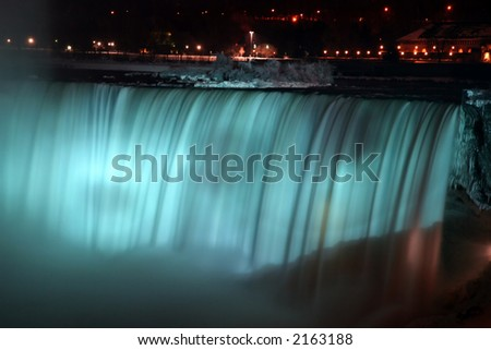 Niagara Horse Shoe Falls at Night with Blue Lights - stock photo