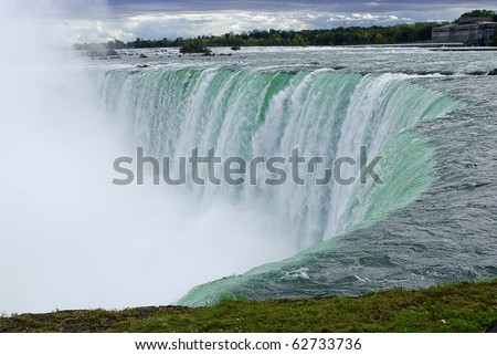 Niagara River and edge of the Canadian horseshoe section of Niagara Falls - stock photo