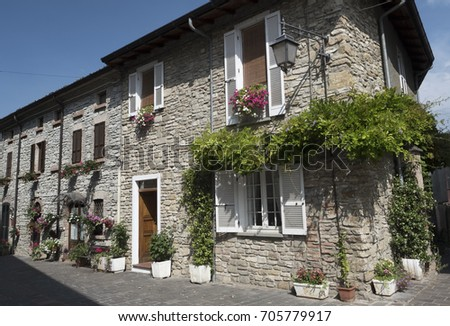Nibbiano (Piacenza, Emilia-Romagna, Italy): old typical house exterior with plants and flowers