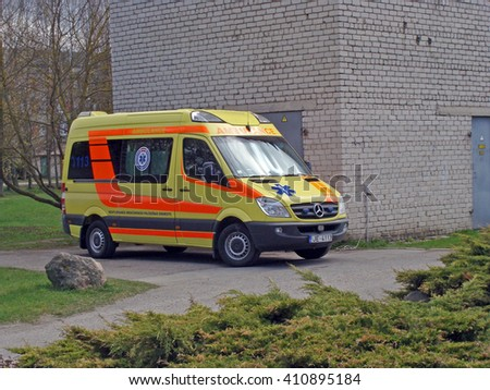 NICA, LATVIA - APRIL 25, 2016: Emergency minibus daily is parked near ambulance and ready to drive. - stock photo