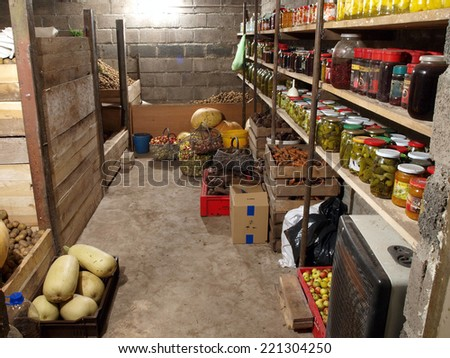 NICA, LATVIA - OCTOBER 3, 2014: House cellar is full with vegetables and preserved products for winter use.      - stock photo