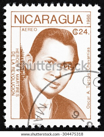 "NICARAGUA - CIRCA 1988: A stamp printed in Nicaragua from the ""Revolutionaries "" issue shows Oscar A. Turcios Chavarrias, circa 1988. - stock photo"