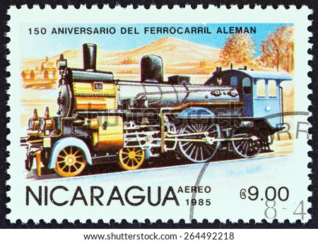 """NICARAGUA - CIRCA 1985: A stamp printed in Nicaragua from the """"150th anniversary of German Railroad """" issue shows Steam locomotive No. 88, Prussia, circa 1985.  - stock photo"""