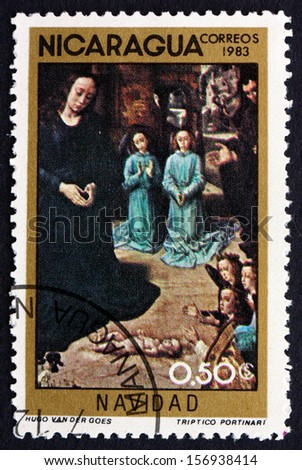 NICARAGUA - CIRCA 1983: a stamp printed in Nicaragua shows Adoration of the Kings, Painting by Hugo van der Goes, Christmas, circa 1983 - stock photo
