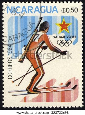 NICARAGUA - CIRCA 1984: A stamp printed in Nicaragua shows biathlon, circa 1984 - stock photo