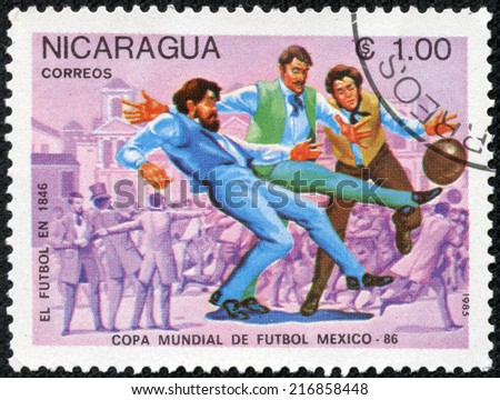 NICARAGUA - CIRCA 1985: a stamp printed in Nicaragua shows Evolution of Soccer, 1846, 1986 World Cup Soccer Championships, Mexico, circa 1985 - stock photo