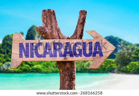 Nicaragua wooden sign with beach background - stock photo
