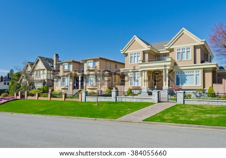 Nice and comfortable great neighborhood, community.  Some homes at the empty street  in the suburbs of Vancouver, Canada. - stock photo