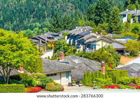 Nice and comfortable great neighborhood, community. Some homes on the empty street in the suburbs of Vancouver, Canada. - stock photo