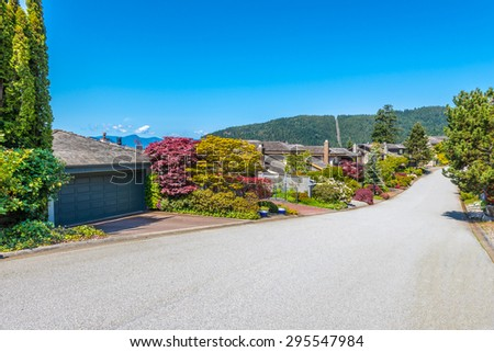 Nice and comfortable great neighborhood. Homes on the empty street in the suburbs of Vancouver, Canada. - stock photo