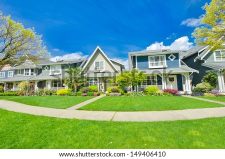 Nice and comfortable neighborhood. A row, line of the houses, homes in the suburbs of the North America. Canada. - stock photo