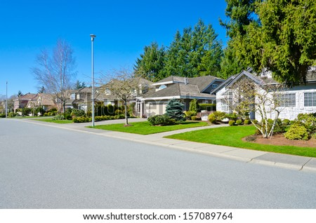 Nice and comfortable neighborhood. A row, line of the houses, homes in the suburbs of Vancouver Canada.