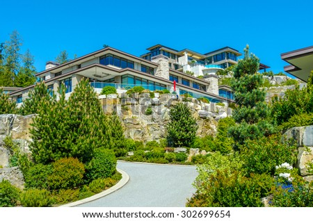 Nice and comfortable neighborhood. Big custom made luxury modern houses on the rocks in the suburbs of Vancouver, Canada. - stock photo