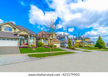 Nice and comfortable neighborhood. Houses on the empty street in the suburbs of Vancouver, Canada.