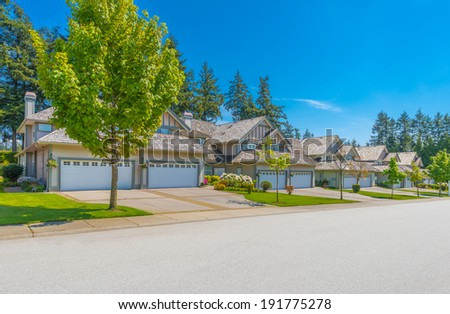 Nice and comfortable neighborhood. Some homes on the empty street in the suburbs of Vancouver, Canada. - stock photo
