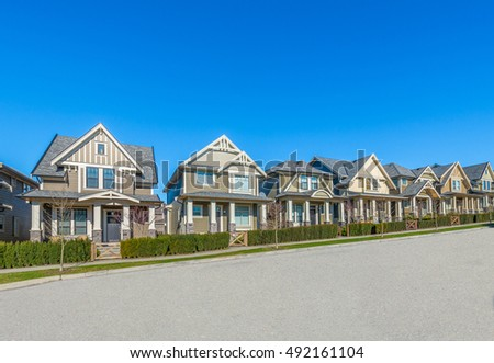 Suburban street stock images royalty free images for Nice houses in canada