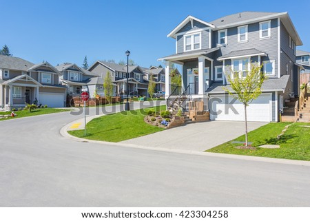 Nice and comfortable street area. Some homes in the suburbs of the North America. Canada.