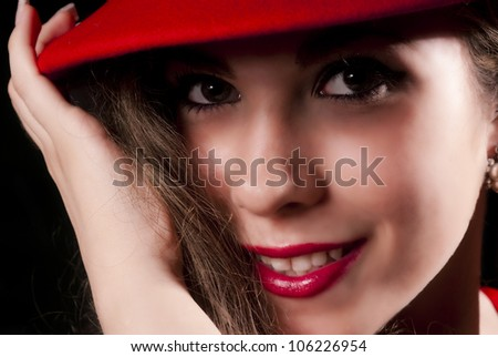 Nice and elegant young woman with a red hat, smiling. - stock photo