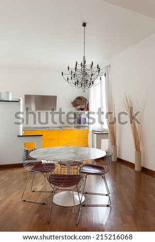 Nice apartment, interior, comfortable dining room, parquet floor - stock photo