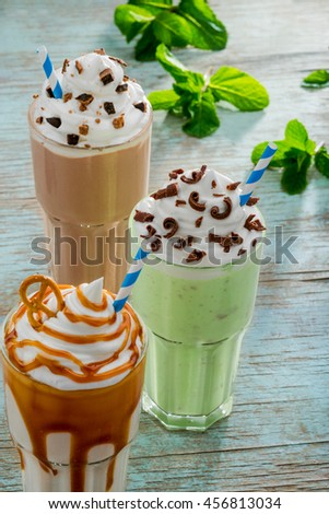 Nice assortment of yummy traditional drinks from America. Lovely ingredients as mint, chocolate, caramel and vanilla are awesome in the combination with ice cream and milk. - stock photo
