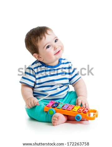 Nice baby playing  with musical toys - stock photo