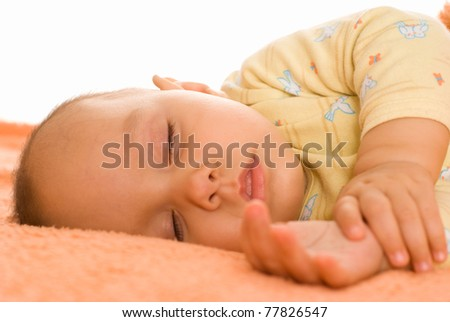 nice baby sleeping on the orange towel