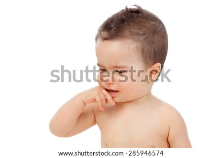 Nice baby with sore gums isolated on a white background - stock photo