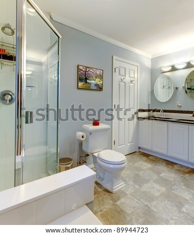 Nice bathroom with shower and double sinks.