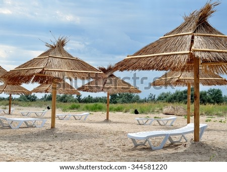 Nice beach with beach chairs and thatched umbrellas