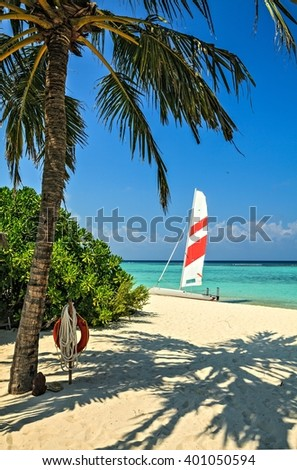 Nice beach with yacht in the tropical hotel Palm Beach, Maldives, The Indian Ocean - stock photo