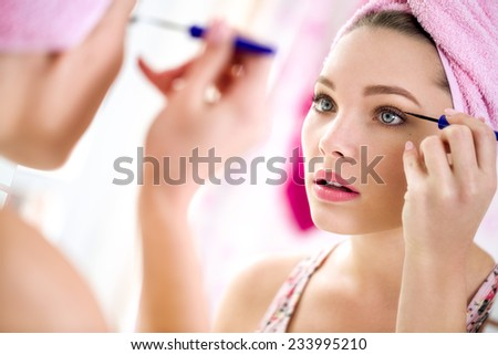 nice beautiful girl make up  front mirror  - stock photo