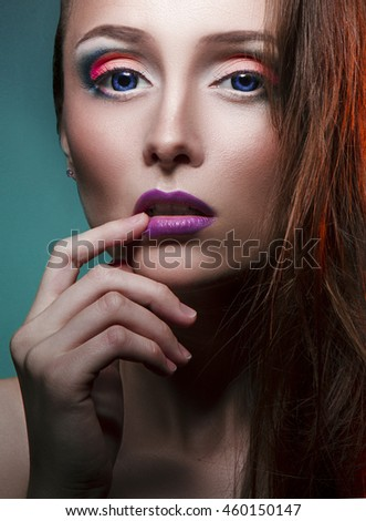 nice beautiful girl with blue eyes and lovely makeup on face