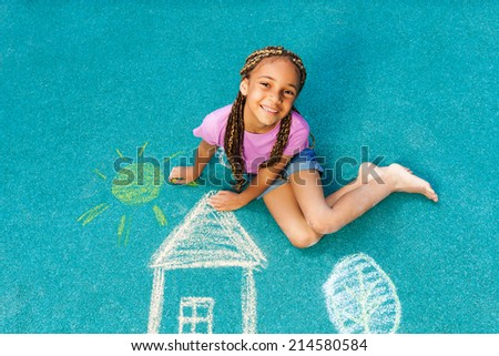 Nice black girl with chalk drawing  - stock photo