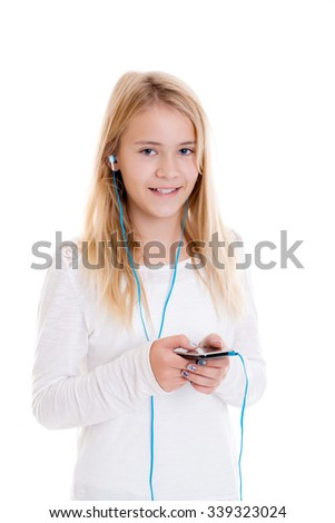 nice blond girl in front of white background listening music