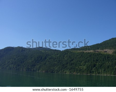 Nice blue sky above some mountains - stock photo